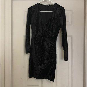 Black long sleeved velvet dress